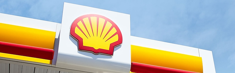 shell service station pecten sky blue